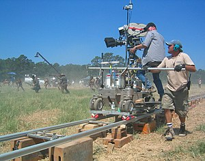 Grip (job) - Cameraman and dolly grip filming The Alamo (2004)
