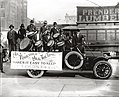 "An African-American drumming group perform on the back of a truck carrying a banner that reads ""All Together All The Time Makes It Easy To Keep St. Louis Clean"" on Market Street.jpg"