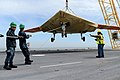 An X-47B is loaded onto flight deck aboard USS George H.W. Bush. (8721193532).jpg