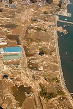 An aerial view of tsunami damage in an area north of Sendai, Japan, taken from a U.S. Navy helicopter.jpg