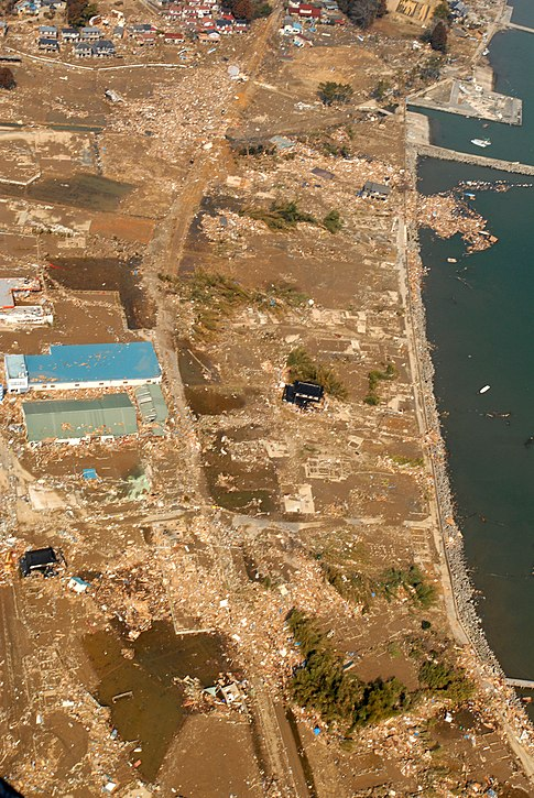 An aerial view of tsunami damage in an area north of Sendai, Japan, taken from a U.S. Navy helicopter. Image: U.S. Navy.