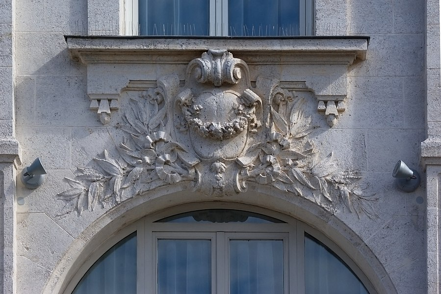 Carving of the XIXth century between two windows on Guez-de-Balzac birthplace (XVIth century). Angoulême, Charente, France.