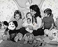 Annette Funicello sitting on bed with children 1975.jpg