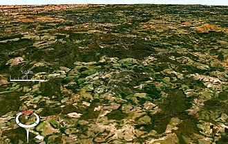 Araguainha crater - Oblique Landsat image of Araguainha crater draped over digital elevation model (x5 vertical exaggeration); screen capture from NASA World Wind