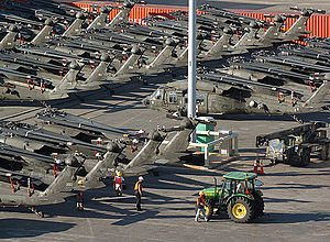 Combat Aviation Brigade, 10th Mountain Division - UH-60 Black Hawk helicopters of the 10th Combat Aviation Brigade are loaded into a ship in preparation for a 2008 deployment to Iraq.