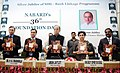 Arun Jaitley releasing the book on 'Status of Micro Finance in India 2016-17', at the 36th NABARD Foundation Day and Silver Jubilee of SHG Bank Linkage Programme, in New Delhi.jpg