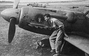 Ezer Weizman - Weizman sits upon the wing root of an Avia S-199, a Czechoslovak-built version of the Bf 109.