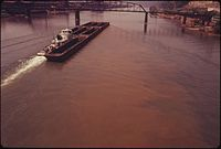 BARGE ON THE MONONGAHELA RIVER SHOWS EFFECTS OF POLLUTION CAUSED BY AN OIL SPILL AT THE DUQUESNE WORKS OF THE UNITED... - NARA - 557235.jpg