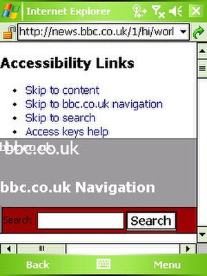 Computer accessibility - BBC News shown in 'desktop mode,' with Accessibility links at the top. The screenshot is taken from Windows Mobile.