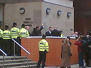 Nick Griffin and Mark Collett leave Leeds Crown Court on 10 November 2006 after being found not guilty of charges of incitement to racial hatred at their retrial.