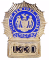 Badge of a New York City Police Department detective.png