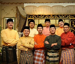 Baju Melayu - A group of men in the Cekak Musang type, worn together with the songket.