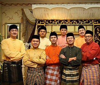 Malays (ethnic group) - A group of men from Brunei Darussalam in the Cekak Musang type, worn together with the songket (far left) and kain sarong.