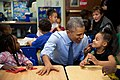 Barack Obama gestures as he talks with Akira Cooper, 2015.jpg