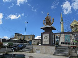 Statue in village square of Benis. The mosque can be seen in the background.