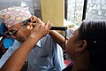 Bhim Bahadur Thapa, age 62 visits the tempoary clinic with an ear problem. (10677124544).jpg