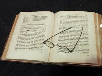 Experiments and Observations on Electricity - Fourth edition volume increased to 496 pages.   Had hard covers and additions to third edition.   (Franklin's bifocal glasses shown on the book)