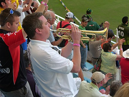 Trumpeter Billy Cooper Cheering England at 1st Test vs Pakistan Dubai January 2012 Billy the trumpeter.JPG