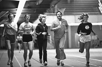 Title IX - Senator Bayh exercises with female athletes at Purdue University, ca. 1970s.