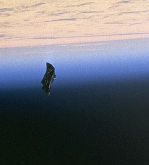Space debris - A drifting thermal blanket photographed in 1998 during STS-88.