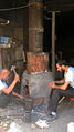 Blacksmith and his son in the Bazaar of Nishapur 1.JPG
