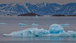 Blue icebergs floating in Liefdefjord, Svalbard.jpg