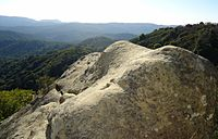 Boulder near cliffside at Castle Rock State Park.jpg