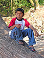 Boy sitting on tree trunk in Guatemala.jpg