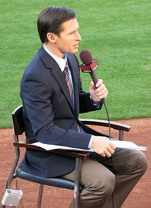 Brad Adam - ROOT Sports broadcaster Brad Adams prepares a pregame segment at a Seattle Mariners vs. Oakland Athletics game in Oakland in April 2013.