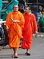 Buddhist Monks in Street - Kampong Cham - Cambodia (48363489556).jpg