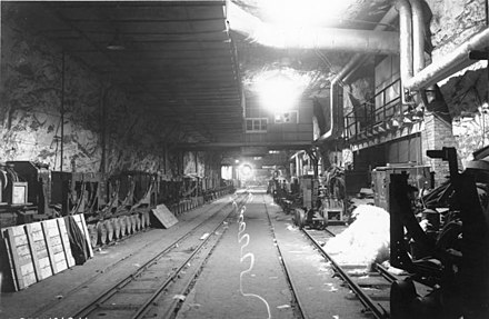 Manufacture of V-1 and V-2 rockets in the Mittelwerk tunnels, resulting in the deaths of more than 12,000 people Bundesarchiv Bild 146-1991-061-17, Niedersachswerfen, Produktion von V1 - V2.jpg