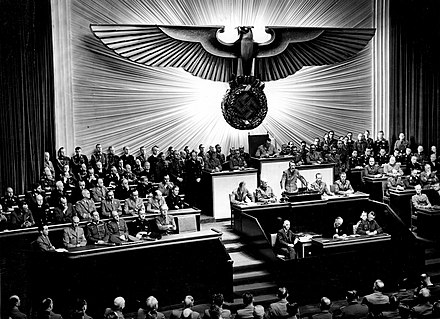 Hitler declares war against the United States on December 11, 1941. Bundesarchiv Bild 183-1987-0703-507, Berlin, Reichstagssitzung, Rede Adolf Hitler.jpg