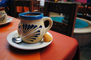 Panela - Mexican café de olla served with a panela lump.