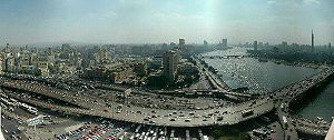6th October Bridge - The 6th October Bridge, ramps, and Nile; with Downtown Cairo and Egyptian Museum (on left), in view north from Hilton tower.