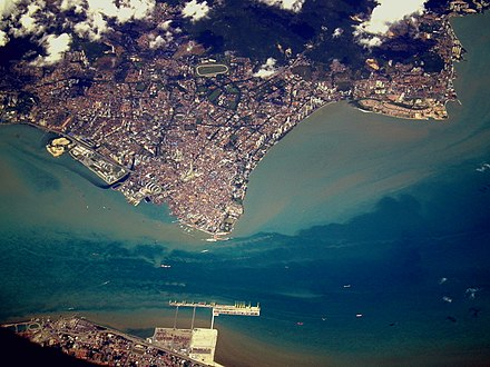 Aerial view of George Town. The city is physically separated from Butterworth (bottom) by the Penang Strait. Calflier001 George Town Penang aerial.jpg