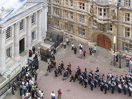 Graduands enter the Senate House at a graduation ceremony Cambridge University graduation enter Senate House.jpg
