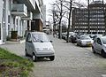 Cars in the city, Amsterdam (33486398775).jpg