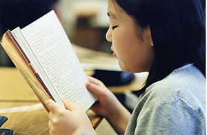 Girl reading a book.