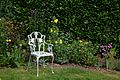 Chair and flower border at Nuthurst West Sussex England.jpg