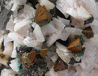 Carbonate minerals - Dolomite with calcite and chalcopyrite from the Picher Field, Tri-State district, Cherokee County, Kansas; 12.0 × 9.7 × 4.3 cm