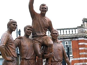 Boleyn Ground - Champions Statue on Barking Road. Left to right: Martin Peters, Geoff Hurst, Bobby Moore (aloft), Ray Wilson.