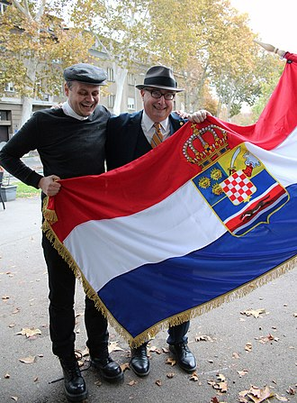 Charles A. Coulombe - Charles A. Coulombe (right) with a Croatian Monarchist holding a Croatian Royal flag