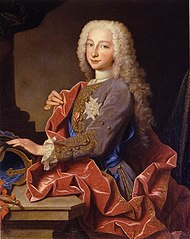 A nine-year-old boy wears a powdered per-wig, striking a typical Baroque pose.