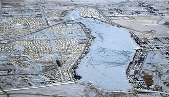17 Avenue SE (Calgary) - Aerial view of Chestermere Lake with the Chestermere Boulevard crossing and interchange with the Trans-Canada Highway.