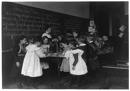 There were many experiments with experiential learning at the time Dewey delivered his lectures. Here young children learn how a compass works by making one in a Washington D. C. school in 1899.