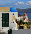 Church dome, bell tower and caldera in Oia, Greece.jpg