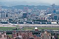 Cityscape around the Songshan Airport from the Jian-nan Mountain 20130719.jpg