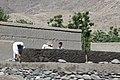 Constructing a mud-brick buildings in Afghanistan.jpg