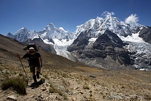 Cordillera Huayhuash - Hiking the Alpine Circuit in the Huayhuash mountain range. In the background are (L to R) Rasac, Yerupaja, Siula Grande and Sarapo.