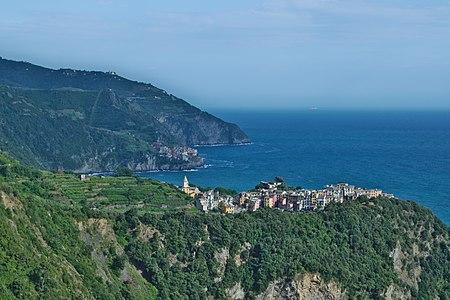 Distant view of Corniglia and Manarola from the Azure Trail, Cinque Terre, Italy.
